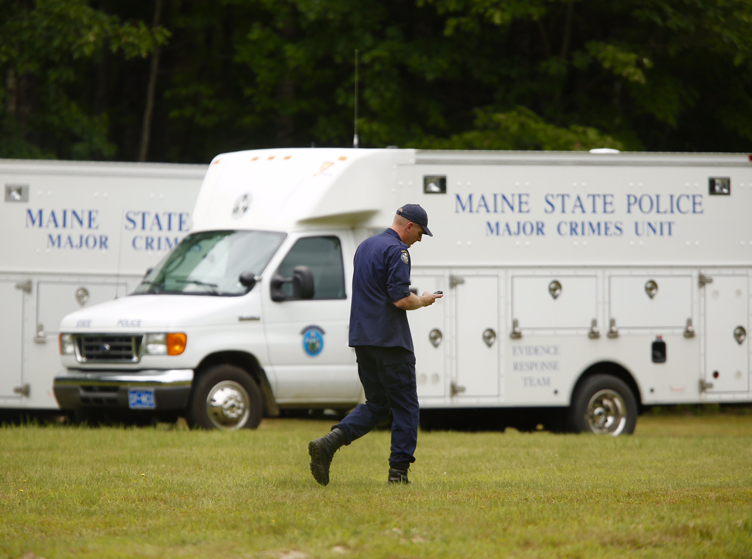 A Maine law enforcement investigator walks at the scene where a search for clues into what happened Kimberly Moreau. Carl D. Walsh/Staff Photographer