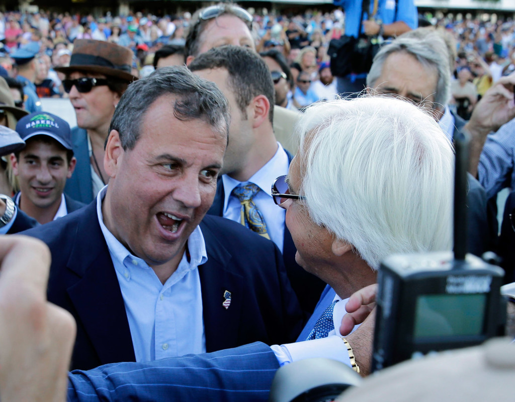 New Jersey Gov. Chris Christie, left, congratulates Triple Crown winner American Pharoah's trainer Bob Baffert after American Pharoah won the Haskell Invitational horse race at Monmouth Park in Oceanport, N.J., on Sunday. Christie on Sunday called a national teachers union