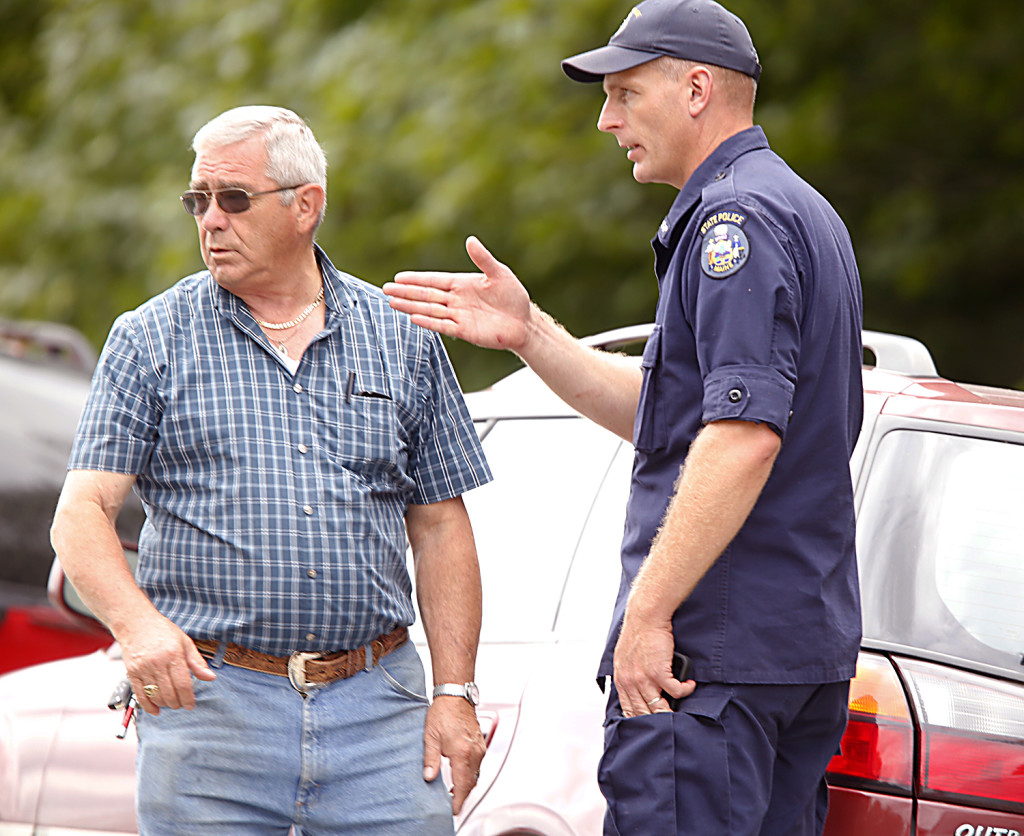 Richard Moreau, father of Kimberly Moreau who has been missing since 1986, and a Maine State Police investigator, talk outside a Rt. 108, Canton scene where Maine law officials were searching on Sunday. Carl D. Walsh/Staff Photographer