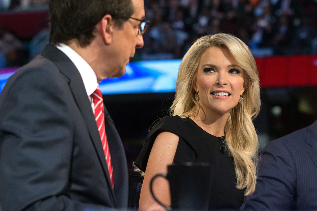 Fox News moderator Megyn Kelly, right, listens as Chris Wallace, begins introductions during the first Republican presidential debate at the Quicken Loans Arena, in Cleveland. Angry over what he considered unfair treatment at the debate, Republican presidential candidate Donald Trump told CNN on Friday night that Kelly had