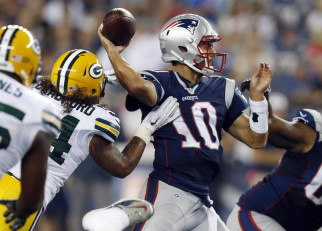 Jimmy Garoppolo completed 20 of 30 passes for 159 yards Thursday night for the New England Patriots, but wasn't helped by his teammates. With the starters not playing, Garoppolo was sacked seven times, but also made mistakes of his own. The Associated Press