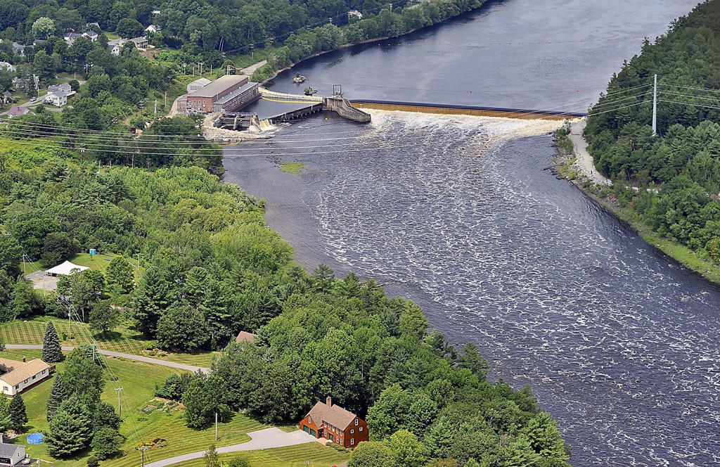 On Monday, July 22,  2013, construction workers breached the Veazie Dam, upper left, in preparation for its removal on the Penobscot River in Eddington, Maine. Gordon Chibroski/ Staff Photographer