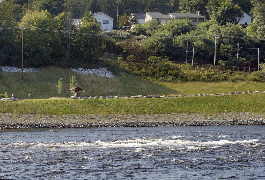 """Barbara Wilson lived above the Veazie Dam for 40 years in the house at left in this photo and used to refer to the dam as """"her waterfall."""" She was initially opposed to the dam removal but says she now likes having the Penobscot River run free below her home. Gregory Rec/Staff Photographer"""