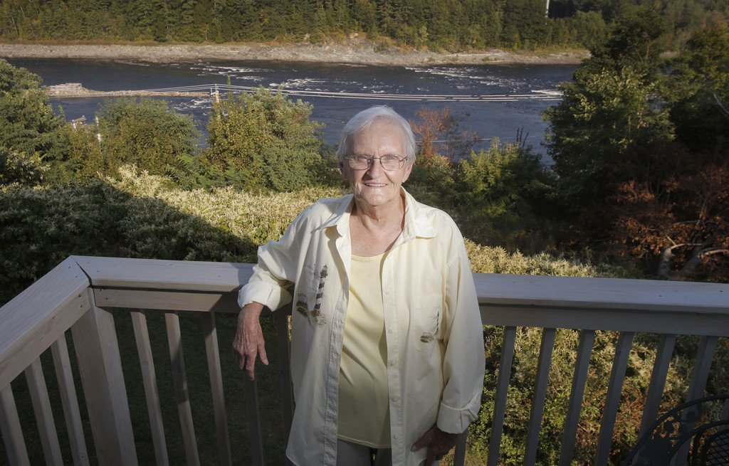 """Barbara Wilson lived above the Veazie Dam for 40 years and used to refer to the dam as """"her waterfall."""" She was initially opposed to the dam removal but says she now likes having the Penobscot River run free below her home.    Gregory Rec/Staff Photographer"""