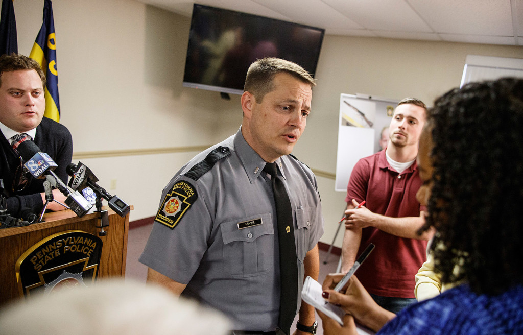 Pennsylvania State Police Cpl. Jonathan Mays speaks to reporters after a press conference Monday, after the arrest of John Wayne Strawser Jr. of West Virginia in the shooting of Timothy