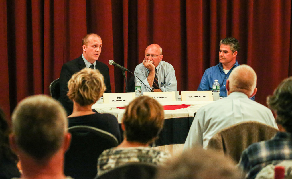 Tom MacMillan, left, Mayor Michael Brennan, center, and Ethan Strimling debate at Mechanic Hall in Portland on September. Electing a mayor gives Portland voters a direct voice in the direction of the city.