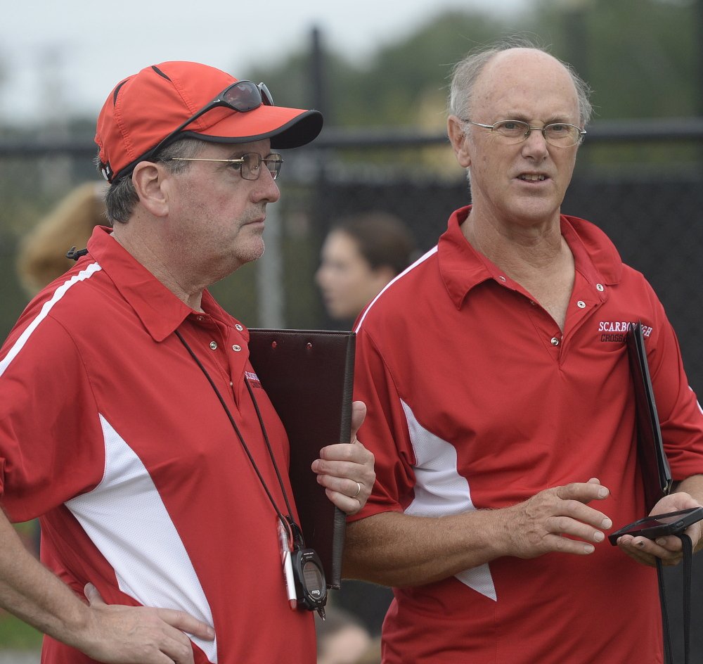 Scarborough cross country coaches Jim Harmon, left, and Ron Kelly share plenty – both love coaching and have been around for a long time.