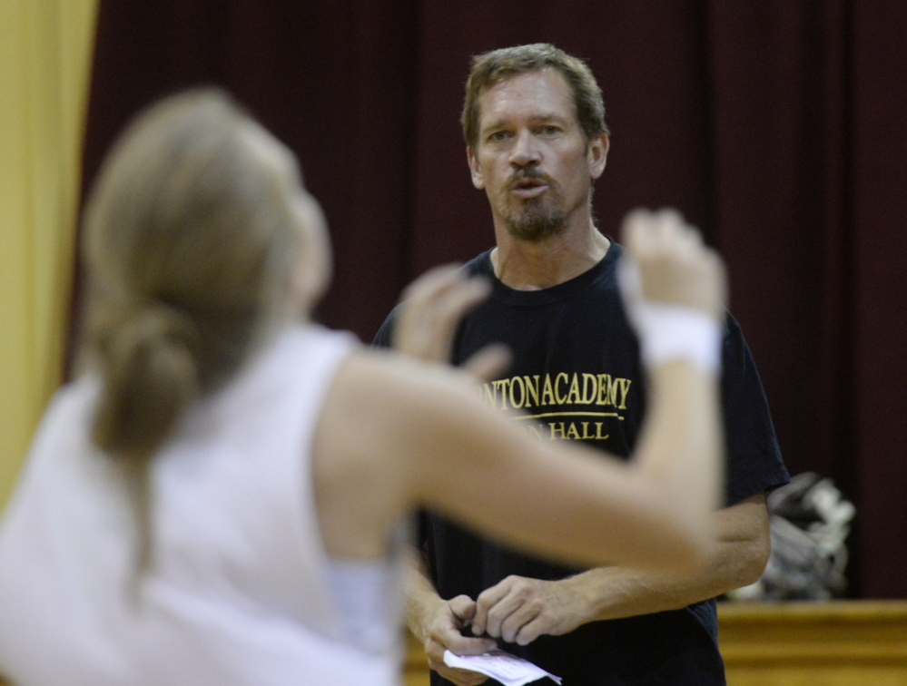 Volleyball coach Keith O'Leary talks with players as they run drills during practice at Thornton Academy. Shawn Patrick Ouellette/Staff Photographer