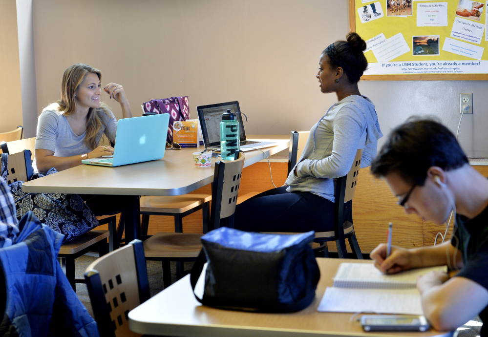 University of Southern Maine students Nicole Kirk, left, and Deonna DaSilva study at the Woodbury Campus Center in Portland on Monday. The university eliminated 51 faculty members last year.