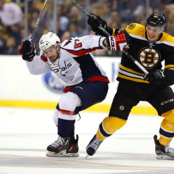Capitals' Liam O'Brien and Bruins' Justin Hickman battle for the puck during the third period of the Bruins' 2-1 win in a preseason game in Boston on Tuesday. The Associated Press