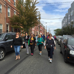 Mainers on a pilgrimage organized by the Roman Catholic Diocese of Portland make their way down 19th Street in Philadelphia on Sunday toward security screenings before attending the Mass celebrated by Pope Francis. Kelley Bouchard/Staff Writer