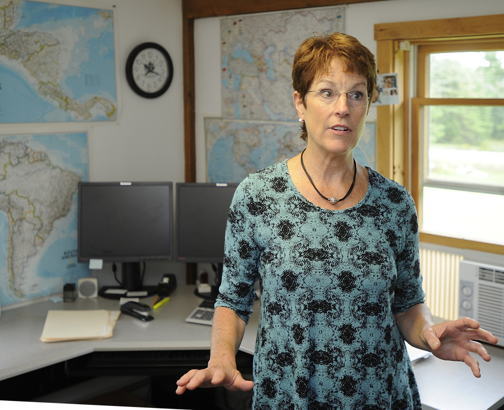 In an office lined with maps, President Connie Justice says Planson International's job is to come up with the best technology solution at the lowest possible price.