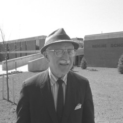 In this April 1974 Press Herald photograph, Howard C. Reiche, former principal of Portland High School, stands in front of the newly-built West End elementary school that was named in his honor.