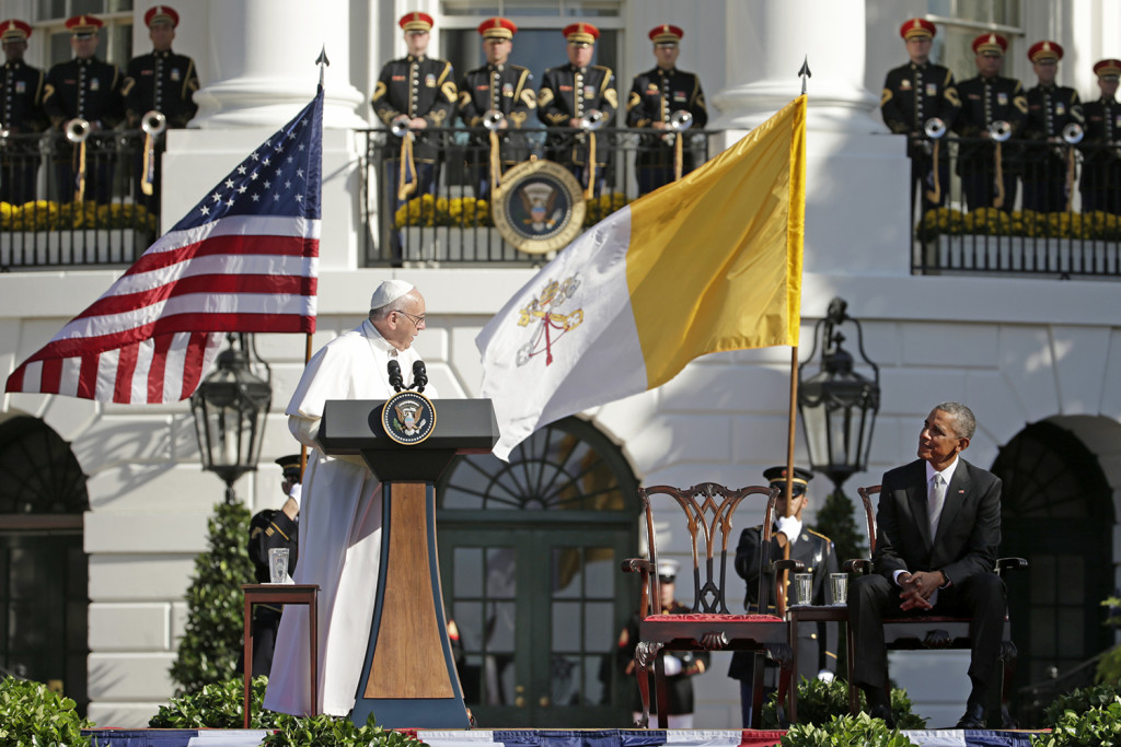 Pope Francis turns toward President Barack Obama during his welcoming remarks at the state arrival ceremony in his honor on the South Lawn of the White House in Washington. The Associated Press