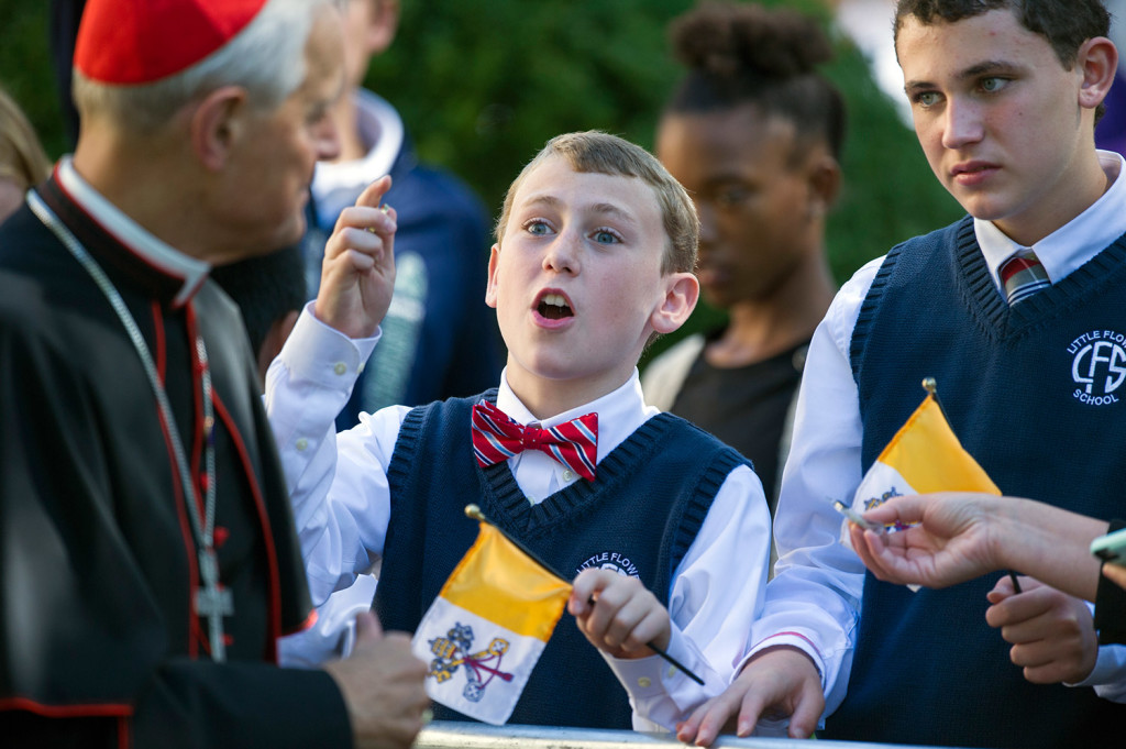 Two schoolboys from the Little Flower School in Bethesda, Md., talk to Cardinal Donald Wuerl, archbishop of Washington, outside of the Apostolic Nunciature, the Vatican's diplomatic mission in Washington, after Pope Francis returned there Wednesday.