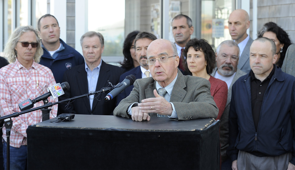 Jim Wellehan, owner of Lamey-Wellehan Shoe Stores, speaks about the harm a proposed referendum to raise the minimum wage would do to the city of Portland as he and other business owners express opposition to the referendum at a news conference at Becky's Diner in Portland on Wednesday.