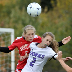 Sanford's Megan O'Connell battles for a header with Marshwood's Natalie DuBois, 2, during the Hawks' 3-1 victory in a Class A South girls' soccer game Monday in North Berwick. The Hawks improved to 7-1, while Sanford fell to 5-2-2.