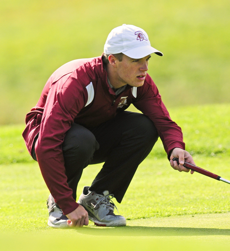 Thornton Academy's Greg Kalagais lines up a putt during state championship golf tournament Saturday at Natanis Golf Club in Vassalboro. Joe Phelan/Staff Photographer