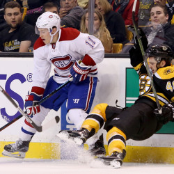 Montreal Canadiens right wing Brendan Gallagher checks Boston Bruins defenseman Colin Miller along the boards in the third period Saturday. The Associated Press