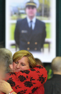 Deb Roberts, mother of Michael Holland, is comforted by a friend during a celebration of her son's life in October, shortly after the sinking of the El Faro.