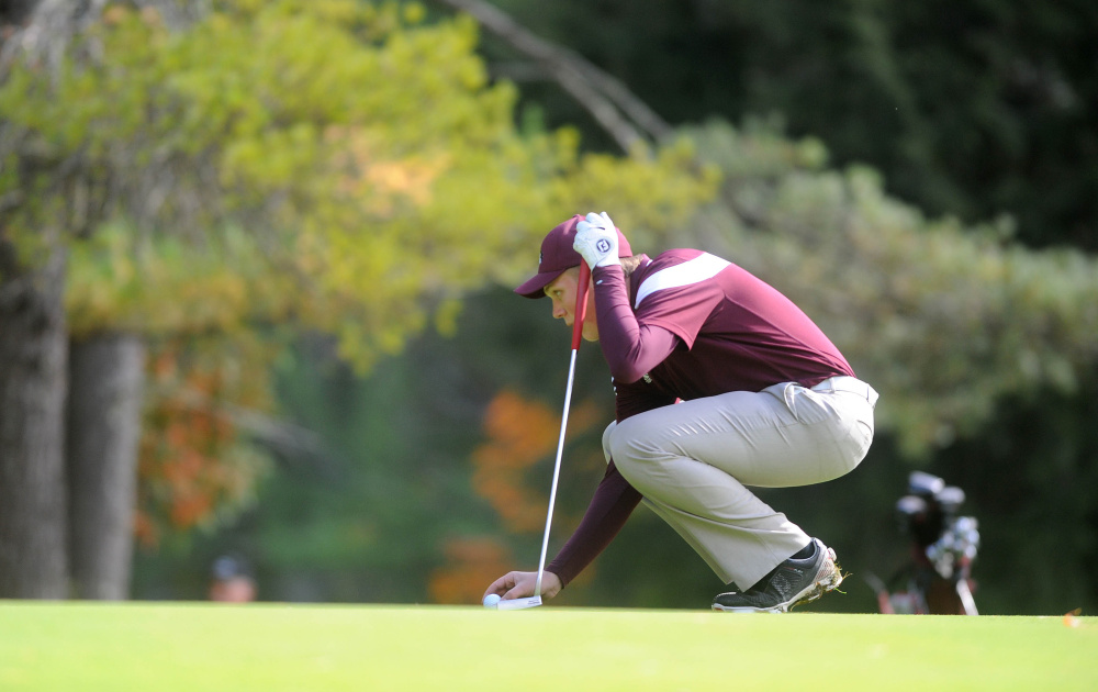 Maine Central Institute's Eric Dugas places his ball on the green as he prepares to putt during the individual state championships Saturday at Natanis Golf Course in Vassalboro.