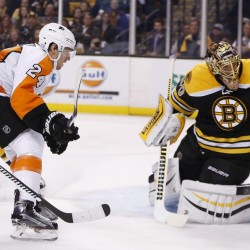 Bruins goalie Tuukka Rask stops the puck as the Flyers' Matt Read comes in for a rebound during the first period of Wednesday night's game in Boston. The Bruins built a 4-2 lead but gave it away in the third period.