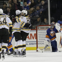 Bruins left wing David Pastrnak (88) celebrates with teammates after scoring the tie-breaking goal in the second period of Boston's win Friday night in New York.