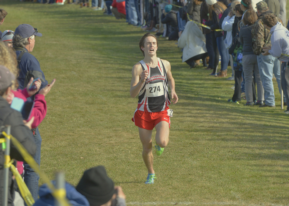 Colin Tardiff of Scarborough heads to the finish line to win the Class A South cross country championship Saturday. Tardiff was timed in 16 minutes, 39.54 seconds for the 3.2-mile course, and the Red Storm dominated in the team competition in Cumberland.