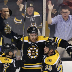 Bruins right wing Jimmy Hayes, center, celebrates after his goal in the second period Tuesday night against the Arizona Coyotes. The Bruins rolled to a 6-0 win.
