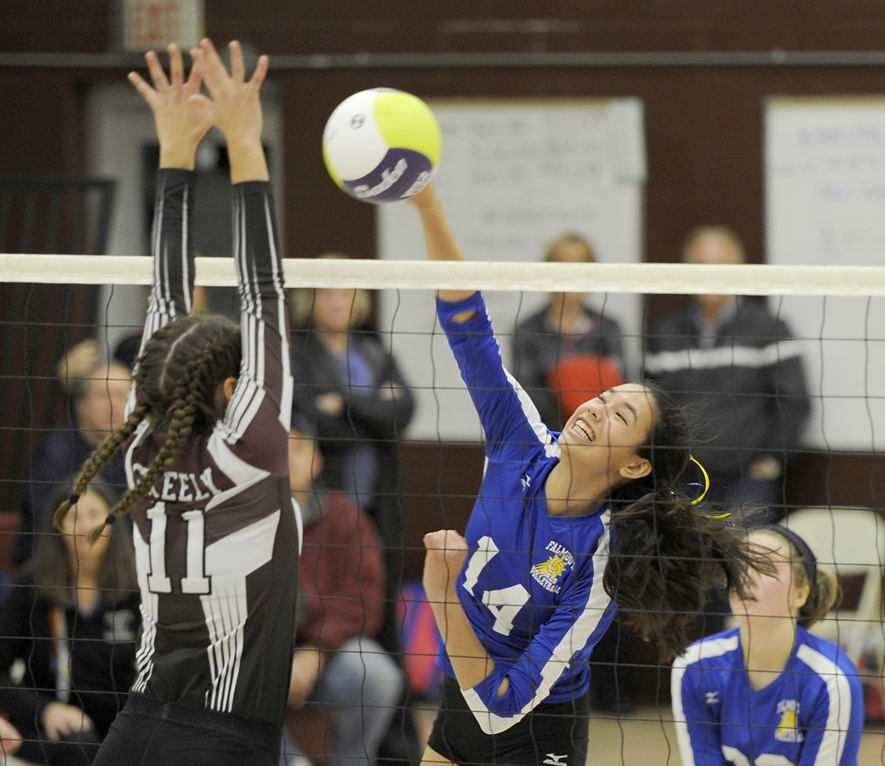 Alison Noyes of Falmouth slams the ball past Molly Chapin of Greely during their Class A volleyball semifinal Wednesday night. Greely won in five sets and will meet Scarborough for the state title Saturday.