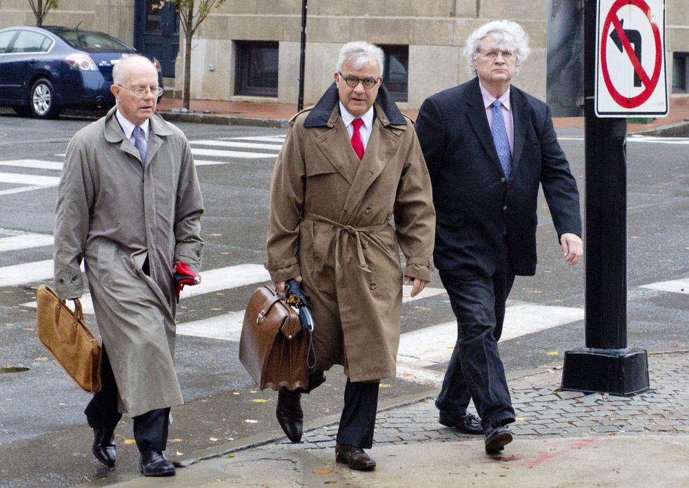 Dr. Joel Sabean of Falmouth, right, walks into U.S. District Court in Portland in October 2015 to face a 58-count indictment, with his attorneys Jay McCloskey and Thimi Mina. On Monday, Sabean's accountant and bookkeeper testified in his trial that they warned the doctor that if he kept sending money to a family member, he would bankrupt his medical practice.