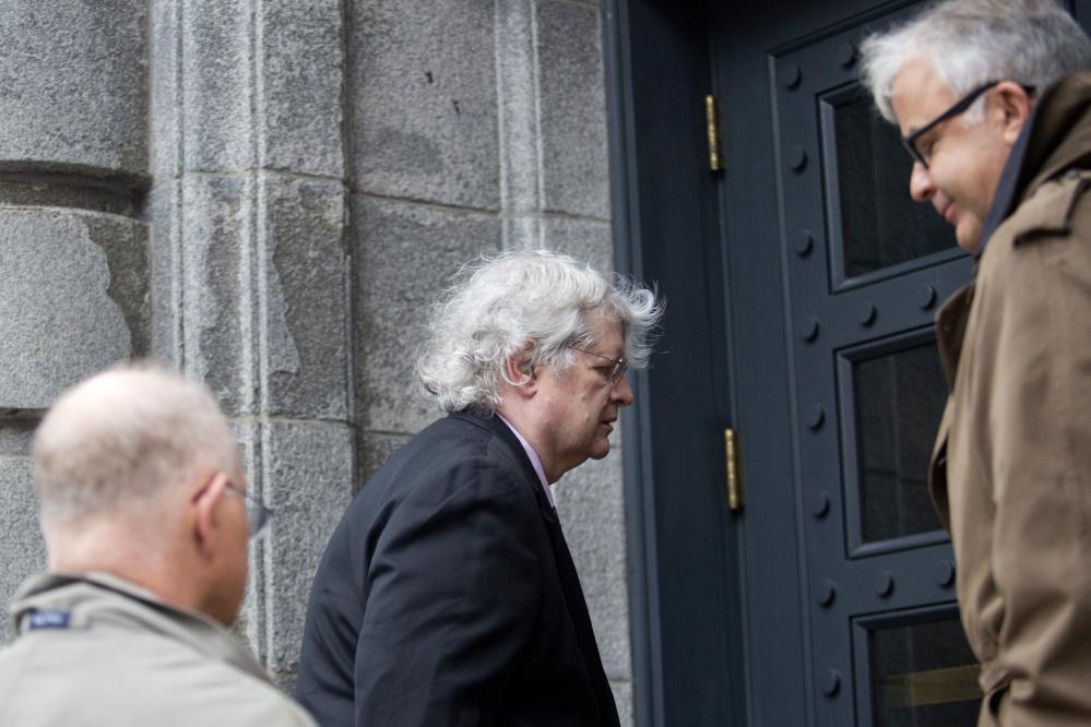 Dr. Joel Sabean, a prominent South Portland dermatologist, enters court in October 2015 with attorneys Jay McCloskey and Thimi R. Mina. Sabean was back in court Tuesday for the start of his trial on charges of tax evasion, illegally distributing controlled substances and health care fraud.