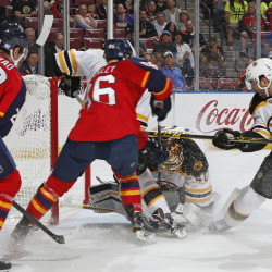 Boston Bruins goaltender Tuukka Rask covers the puck as Florida Panthers center Connor Brickley, 86, attempts to get the rebound during the first period of the Bruins' 3-1 win Friday in Sunrise, Florida.