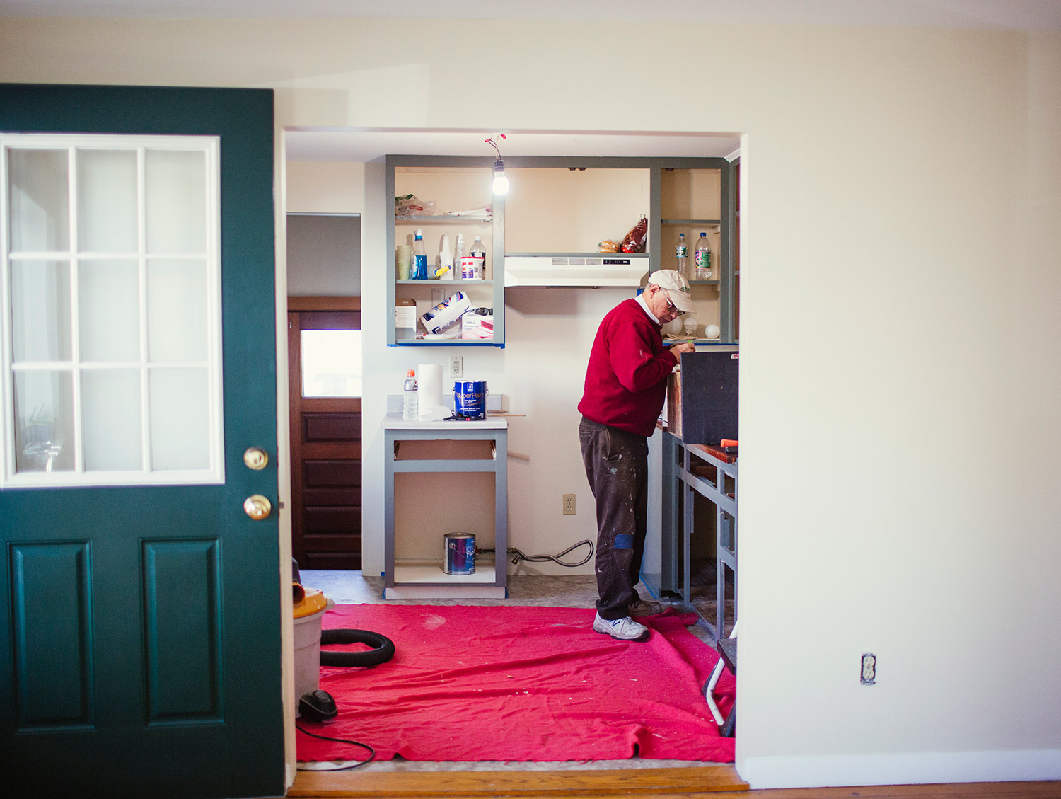 Landlord Carleton Winslow repairs cabinet drawers for the kitchen of a single family home he's renovating in Portland.
