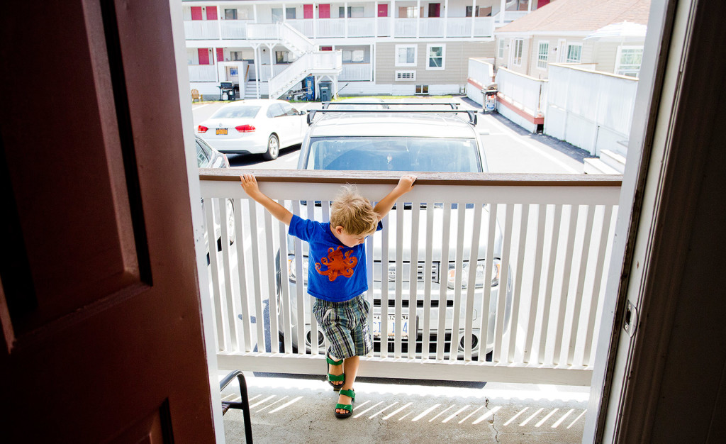 Graham Lavelle, 4, entertains himself in the outside hallway of an Old Orchard Beach motel that he and his family were living in while they looked for an apartment in Portland.