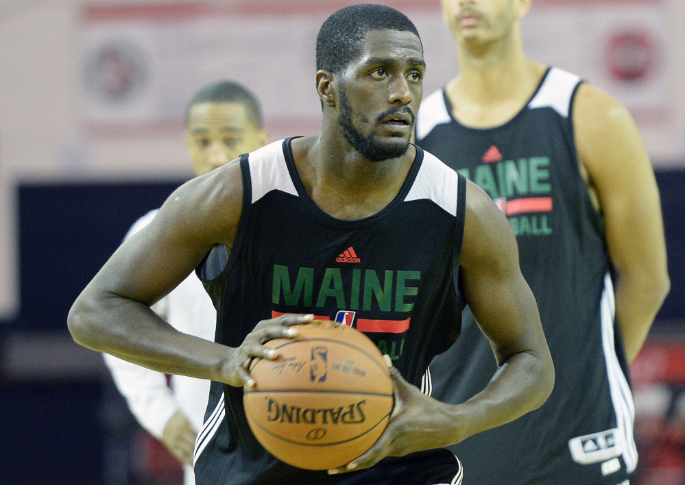 Omari Johnson looks to make a pass during the first day of training camp for the Maine Red Claws on Monday at the Portland Expo. Johnson, who played last season for the Red Claws, was waived by the Portland Trail Blazers late last month.