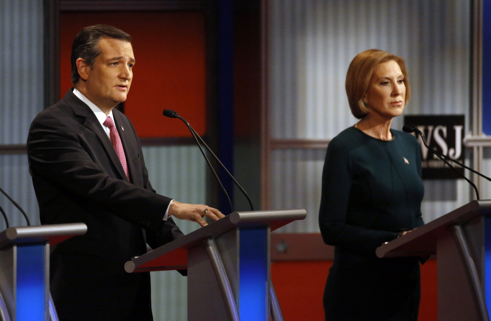 Ted Cruz speaks as Carly Fiorina listens during debate in Milwaukee in November. The Associated Press