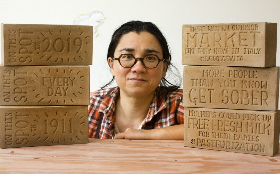 Potter Ayumi Horie, shown with bricks she created to tell stories about the India Street neighborhood in Portland, has received a $50,000 fellowship.