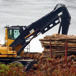 Logs are loaded onto a pulp truck bound for the Madison Paper Industries mill in Madison last month. The U.S. Commerce Department released an analysis Thursday of the impact of the Trans-Pacific Partnership on Maine. According to the federal agency, the trade pact could increase exports by millions, especially in sectors such as  forest products, which tallied more than $700 million in exports in 2014. David Leaming/Morning Sentinel file