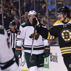 Bruins left wing Loui Eriksson skates past Minnesota Wild defenseman Ryan Suter after scoring his first of three goals in Thursday night's game, during the second period.