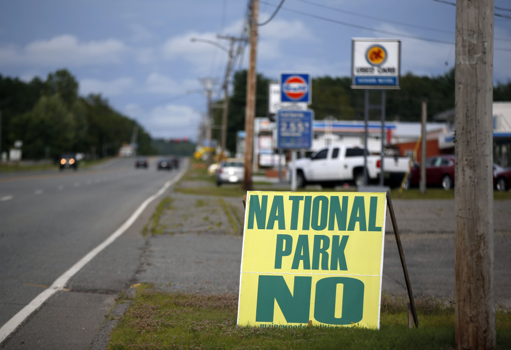 Opposition to a national park is seen on a sign on a road leading into Millinocket in August. Reaction to the national park proposal has been mixed. The Associated Press
