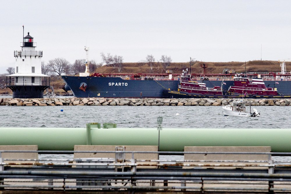 "The oil tanker Sparto carries crude into Portland Harbor on Saturday. Sandy Fielden, director of energy analytics with a Texas consulting firm, said that with shifts in the marketplace and changes in Canada's needs, Portland Pipe Line is on the verge of becoming redundant. ""It's not absolutely dead and buried,"" he said, ""but it's looking like a distressed asset."""