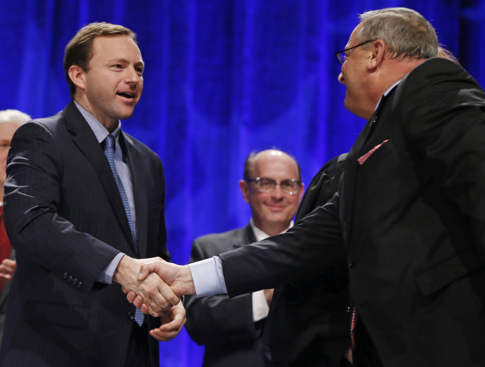 Gov. LePage greets state Rep. Mark Eves before taking the oath of office in January. A reader is deeply troubled that no official action has been taken on the Good Will-Hinckley matter.