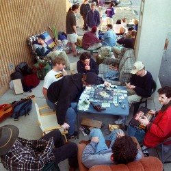 "Eli Meyers, 16, of Yarmouth, picks a card in a game of Star Wars Monopoly that he and a group of Greater Portland Star Wars fans are playing while waiting in line for tickets to ""Star Wars: A Phantom Menace"" at the Falmouth Hoyts Cinemas on May 11, 1999."