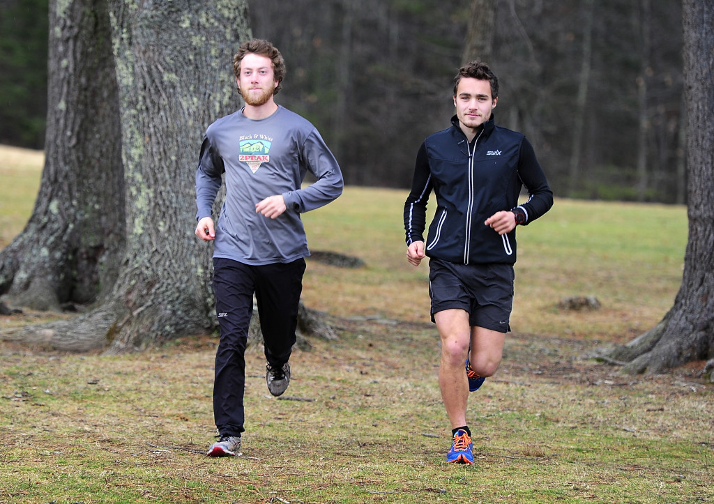 With their endurance about to be tested to the limit by multiple cross-country skiing marathons in Europe, Jackson Bloch, left, and Tyler DeAngelis prep by running the trails at Twin Brook Recreation Area in Cumberland. Gordon Chibroski/Staff Photographer