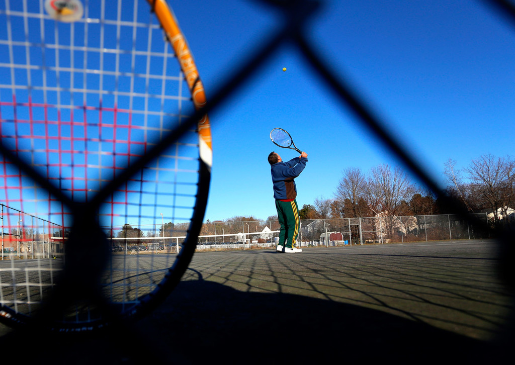 John Shea of Portland practices his serve on the tennis courts at Portland's Riverton Community Center – on Dec. 16.