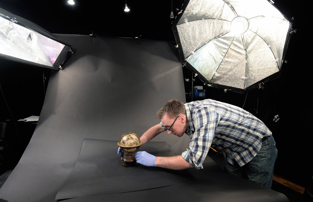 David Neikirk, digital imaging coordinator, sets up a 1607 William Blaeu celestial globe to be photographed at The Osher Map Library.