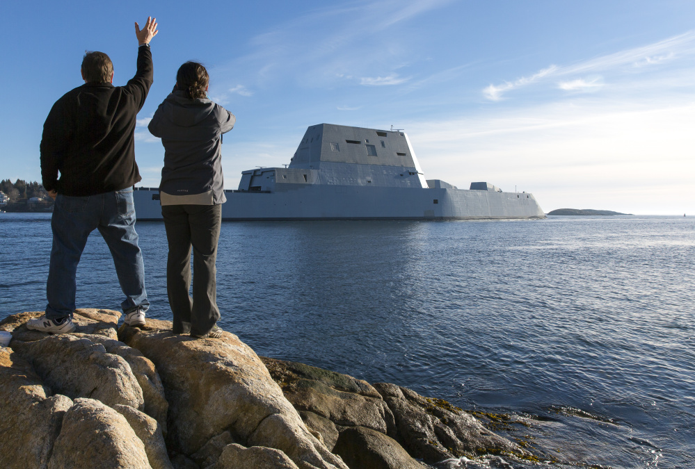 People awaiting the Zumwalt's arrival in Phippsburg waved as the ship headed their way.