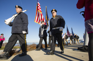 Members of the Amvets Post 6 Color Guard march away at the end of last year's Pearl Harbor remembrance service at Fort Allen Park in Portland.