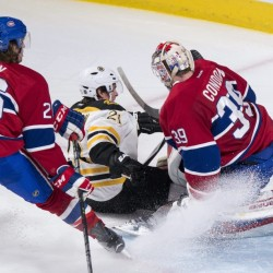 The Bruins' Loui Eriksson slides away from Montreal defenseman Jeff Petry after scoring a short-handed goal past goalie Mike Condon in the third period Wednesday night in Montreal. The goal tied the game, and the Bruins went on to defeat the Canadiens, 3-1.